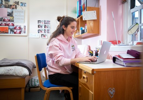 Girl in boarding at Ratcliffe College studying in bedroom. Independent Catholic Boarding School