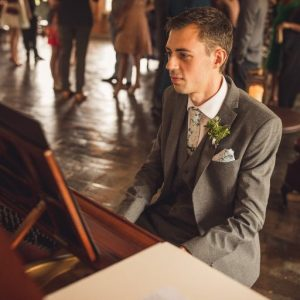 Ratcliffe College teacher playing piano